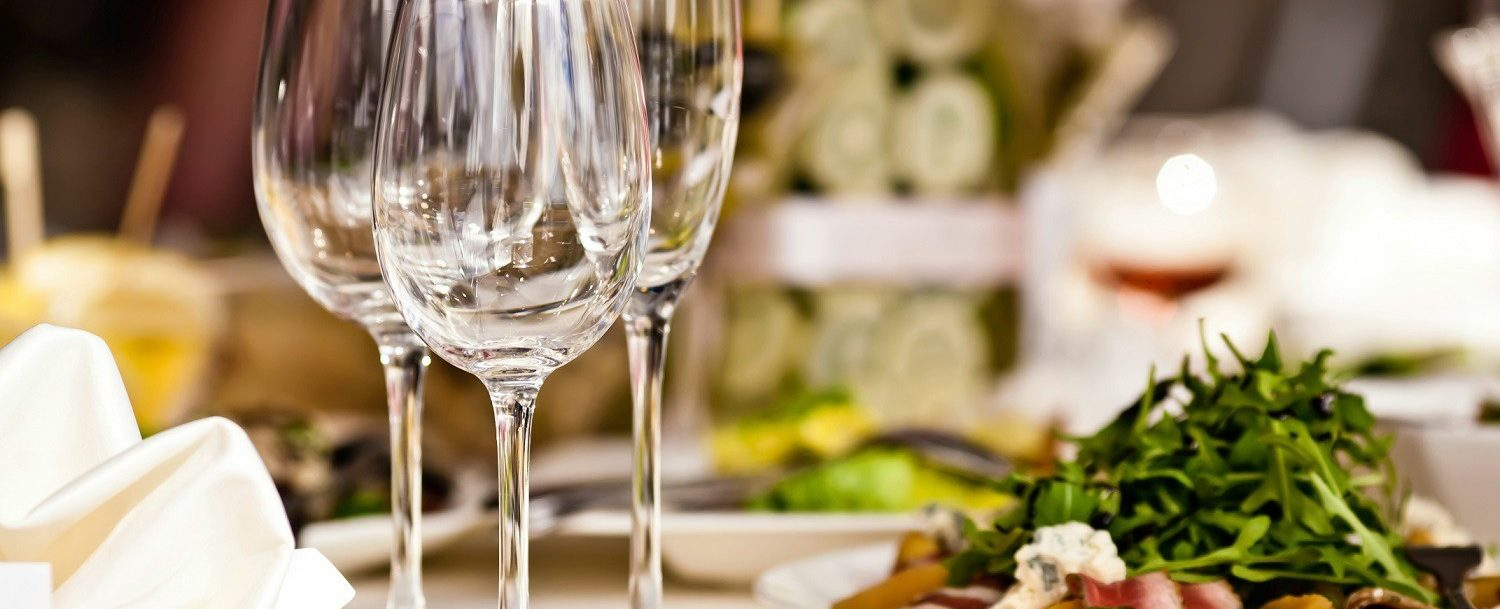 clarence ny restaurants | empty wine glasses next to plates of food