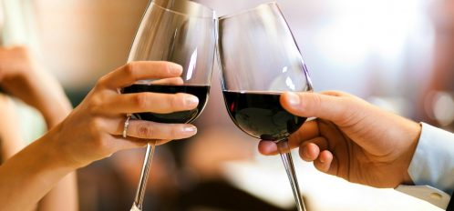 Couple with wine glasses enjoying a romantic getaway in Western NY