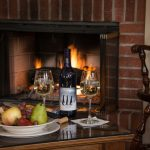 Wine and fruit by the fireplace in the Wilson Greatbatch room