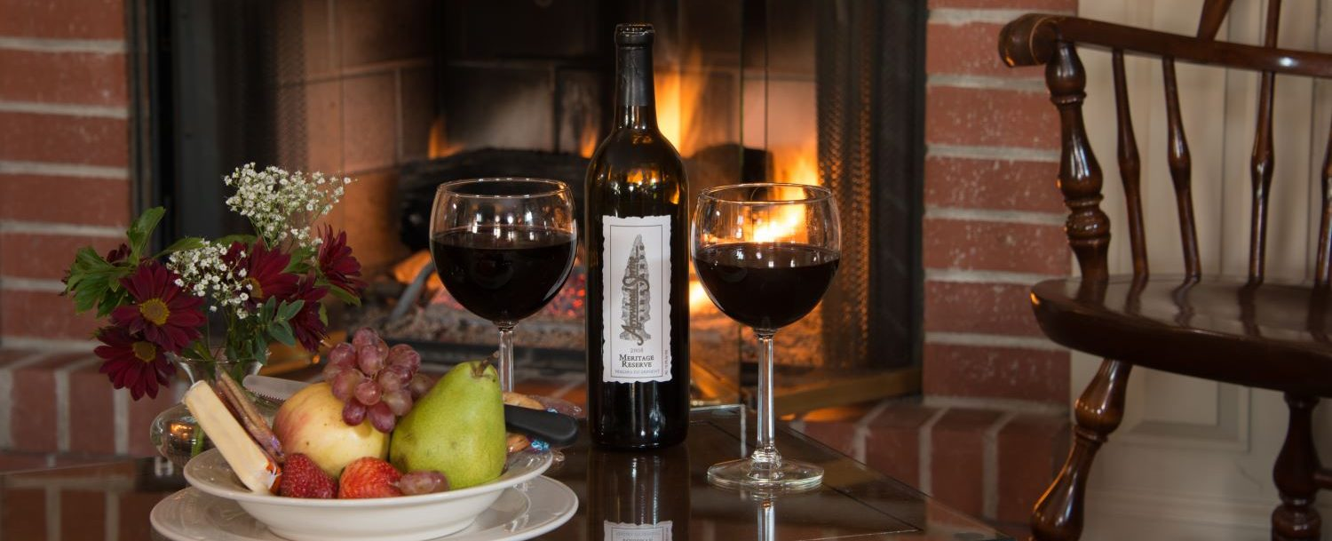 Wine and fruit by a fireplace: perfect environment to enjoy a Western NY getaway package