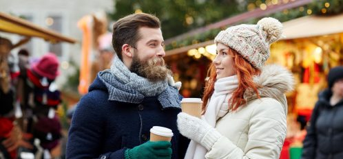 Couple drinking hot cocoa at one of the Buffalo Christmas events